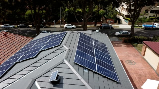 solar panels on the rooftops. aerial view - power in nature stock videos & royalty-free footage