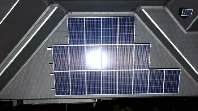 solar panels on the rooftops. aerial view - heat stock videos & royalty-free footage