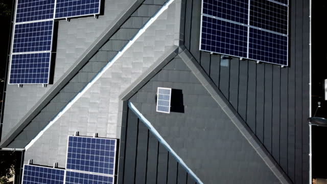 solar panels on the rooftops. aerial view - detached stock videos & royalty-free footage