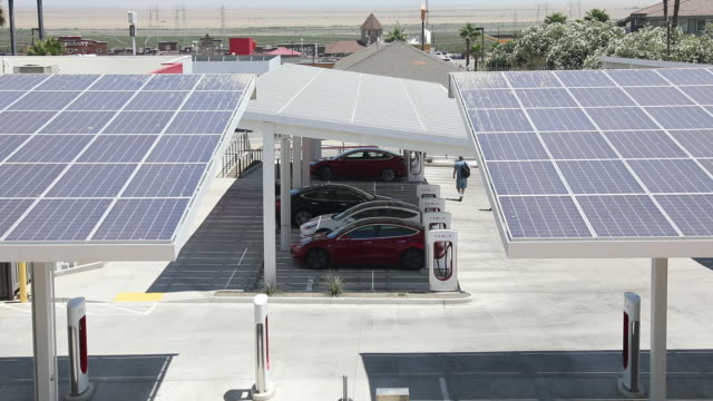 solar panels over tesla supercharger station kettleman city california us on wednesday july 31 2019 - solar panel stock videos & royalty-free footage