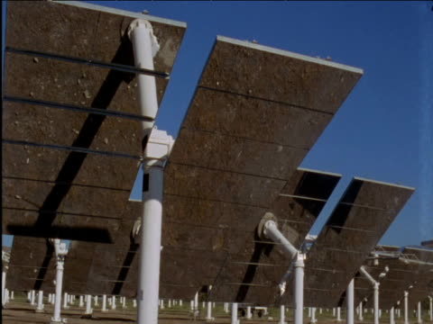 solar panels tilt to track sun spain - solar panels stock videos & royalty-free footage