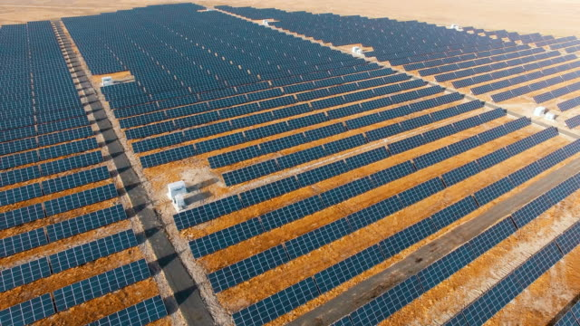solar panels,aerial view - renewable energy stock videos & royalty-free footage