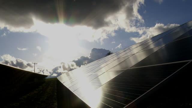 T/L Solar Park Against Dramatic Sky Dolly Shot