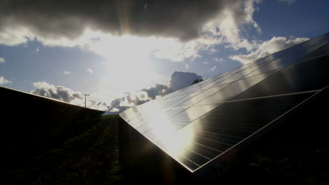 t/l solar park in front of dramatic sky - wolke stock videos & royalty-free footage