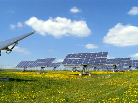 pan solar park in spring - wiese stock videos & royalty-free footage