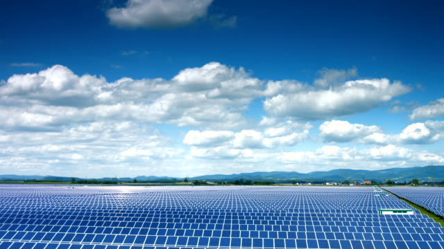 t/l solar power plant in the early summer - solar panels stock videos & royalty-free footage