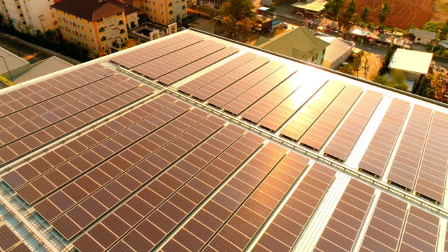 solar power rooftop at sunset - rooftop stock videos & royalty-free footage