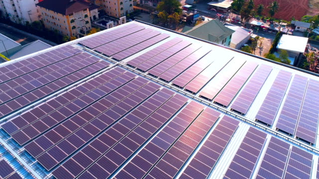 solar power rooftop at sunset - roof stock videos & royalty-free footage