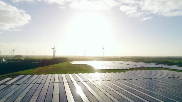 solar power station and wind turbines - 北ホラント州点の映像素材/bロール