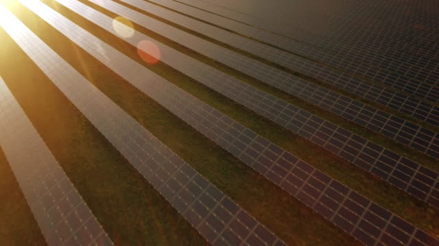 aerial solar power station at sunset flyover shot (4k/uhd) - solar panels stock videos & royalty-free footage