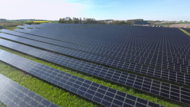aerial solar power station flyover shot (4k/uhd) - industrial equipment stock videos & royalty-free footage