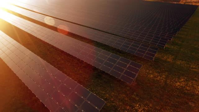 aerial solar power station flyover shot (4k/uhd) - solar panel stock videos & royalty-free footage