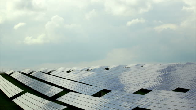 T/L Solar Power Station In Front Of Cloudy Sky (4:2:2)