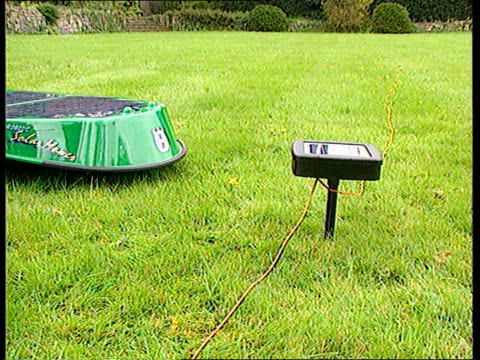 solar powered lawnmower england cms unmanned solar powerd lawnmover moving over grass cms mower turning cms mower away cms mower towards cord around... - time of day stock videos and b-roll footage