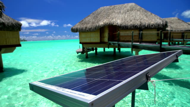 solar powered overwater bungalows aquamarine lagoon bora bora - south pacific ocean stock-videos und b-roll-filmmaterial