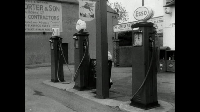 'sold out' sign is placed on petrol station forecourt; 1950 - western script stock videos & royalty-free footage