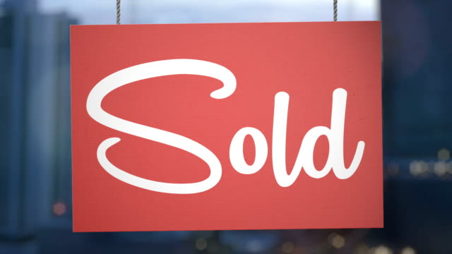 Sold sign hanging from ropes. Luma matte included so you can put your own background.