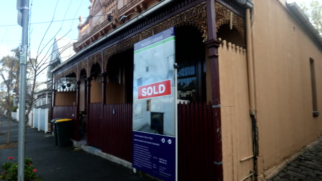 A sold sign is seen on a house in Kensington on July 20 2017 in Melbourne Australia Melbourne house prices have risen consecutively for more than...