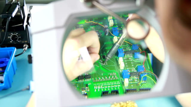 soldering a circuit board - electronics stock videos and b-roll footage