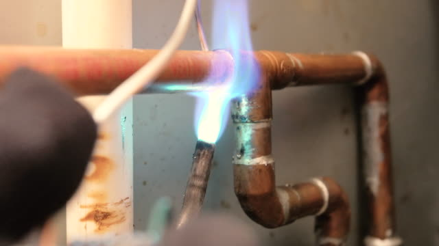soldering copper pipe with torch - plumber stock videos & royalty-free footage