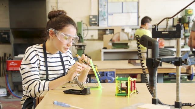 soldering in a lesson - secondary school child stock videos and b-roll footage