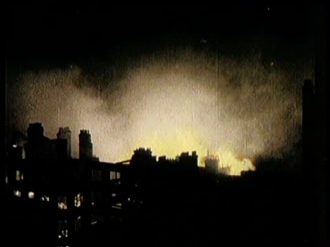 Solders Looking On As Bombs Drop / Fires Across London Rooftops / Flashing Images of Air Assault and Bombings At Night / Flames Shoot From Windows /...
