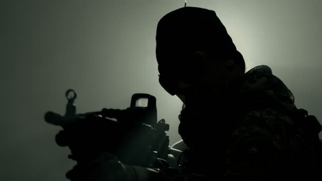 soldier aiming down sight using machine gun. - us navy stock videos & royalty-free footage