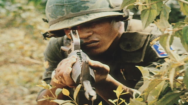 soldier aiming m16 rising from cover and approaching village / vietnam - m16 stock videos & royalty-free footage