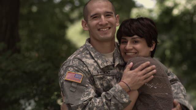 sm ms portrait soldier and his wife turning to look at camera and smile as they hug/ chicago, il - ホームカミング点の映像素材/bロール