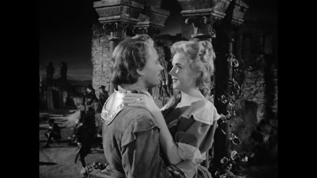 a soldier (william prince) appears surprised when a woman (mala powers) tells him that his daily love letters are behind her visit - xvii° secolo video stock e b–roll