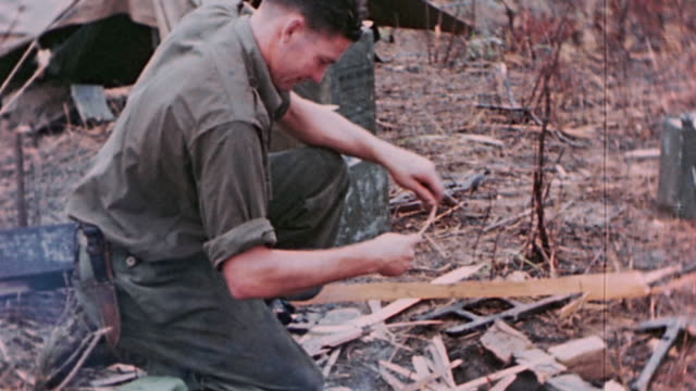 anzac soldier building campfire / the philippines - anzac day stock videos & royalty-free footage