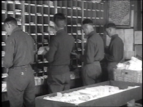 stockvideo's en b-roll-footage met ms soldier clerks in a mail room sorting letters and other soldiers claiming them / camp sherman chillicothe ohio united states - chillicothe