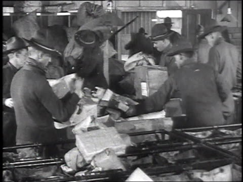 soldier clerks in a mail room sorting packages / camp sherman, chillicothe, ohio, united states - postamt stock-videos und b-roll-filmmaterial