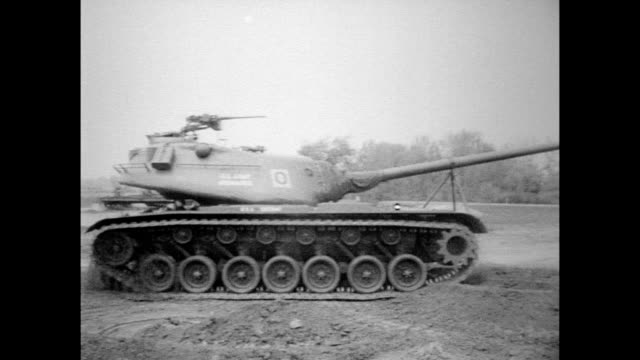 vídeos de stock e filmes b-roll de soldier climbs on top of new t-43 tank and positions himself at gun / gun firing / tank turning to show all sides / tank going up steep hill / tank... - 1954