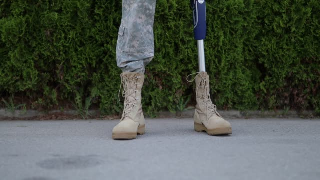 soldier coming home from serving military with amputee leg - homecoming stock videos and b-roll footage