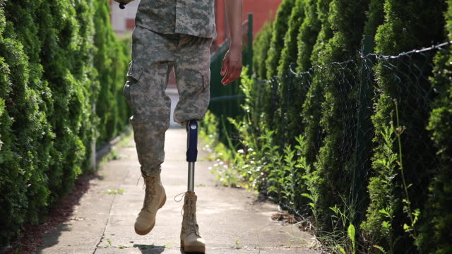 soldier coming home from serving military with amputee leg - prosthetic equipment stock videos & royalty-free footage