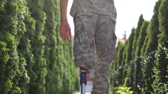 soldier coming home from serving military with amputee leg - us military stock videos & royalty-free footage