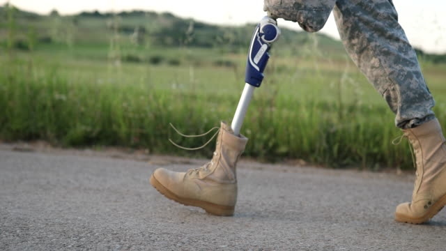 soldier coming home with amputee leg - homecoming stock videos and b-roll footage