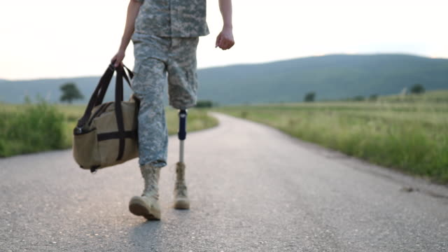 soldier coming home with amputee leg - artificial limb stock videos & royalty-free footage