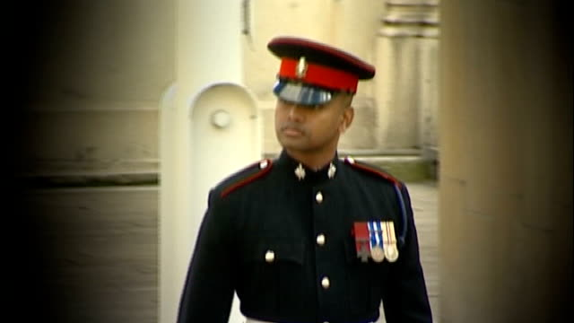 soldier criticises posttraumatic stress treatment 27405 buckingham palace motion shot of beharry arriving at buckingham palace to receive his... - the victoria cross stock-videos und b-roll-filmmaterial