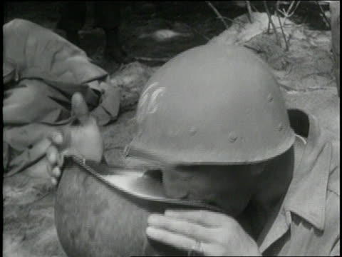 soldier drinks liquid from a helmet and licks his lips. - ヒトの口点の映像素材/bロール