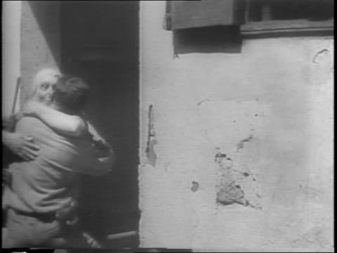 soldier driving in jeep up dirt road, they stop and point / sign on building for the town of mezzojuso / soldier sitting down and jeep continues... - 1943 stock-videos und b-roll-filmmaterial