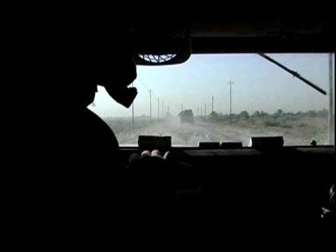 US soldier driving military Humvee on rural road / Baghdad Iraq / AUDIO