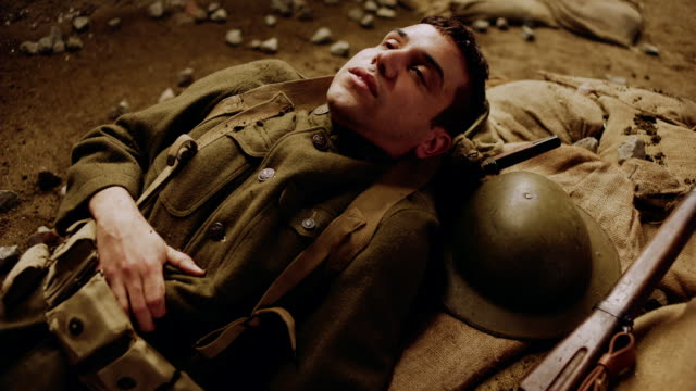 cu soldier dying from a wound - prima guerra mondiale video stock e b–roll