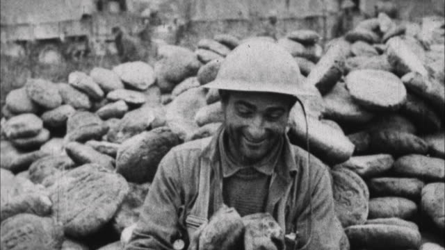 soldier eats loaf of bread / france - soldat stock-videos und b-roll-filmmaterial