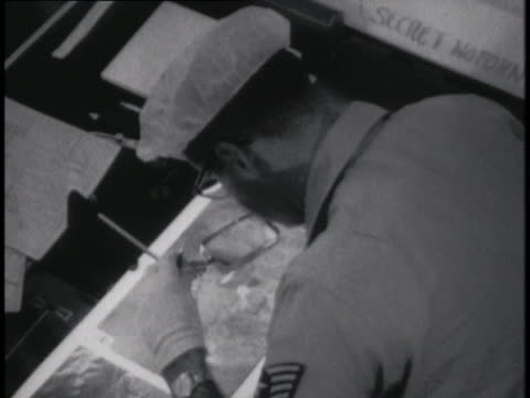 soldier examines photographs taken from the u-2 skyline. - (war or terrorism or election or government or illness or news event or speech or politics or politician or conflict or military or extreme weather or business or economy) and not usa stock videos & royalty-free footage
