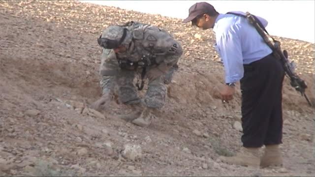 ms soldier examining heap of dirt, barwana, al anbar, iraq - land mine stock videos and b-roll footage