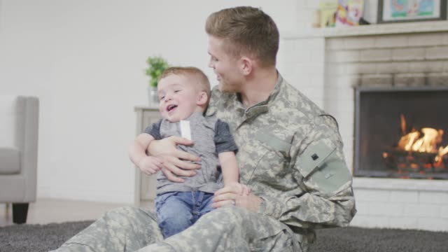 soldier father playing with his baby boy - military recruit stock videos & royalty-free footage