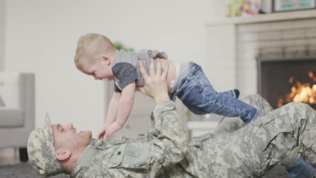 soldier father playing with his baby boy - patriotism stock videos & royalty-free footage