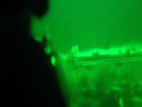 a soldier fires bullets in afghanistan at night - 2001年~ アフガニスタン紛争点の映像素材/bロール